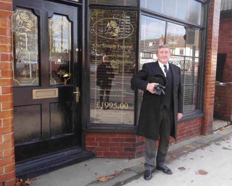 Paul Young, funeral director standing outside his main Askern office on 16 High Street, Askern, Doncaster.