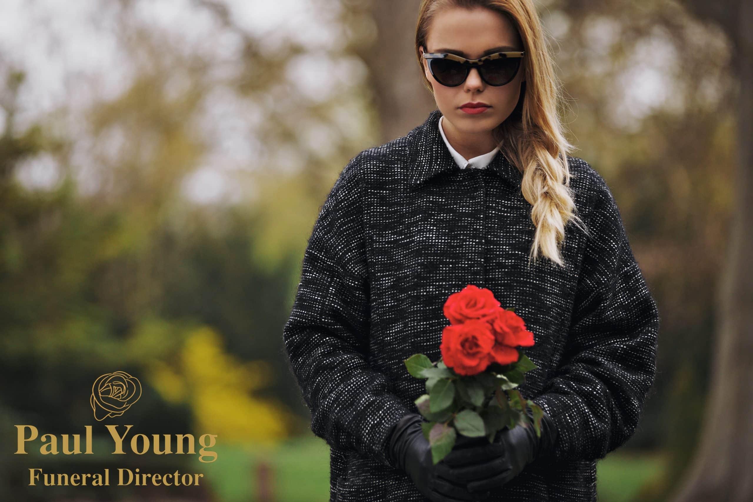 Young woman at graveyard organising a funeral