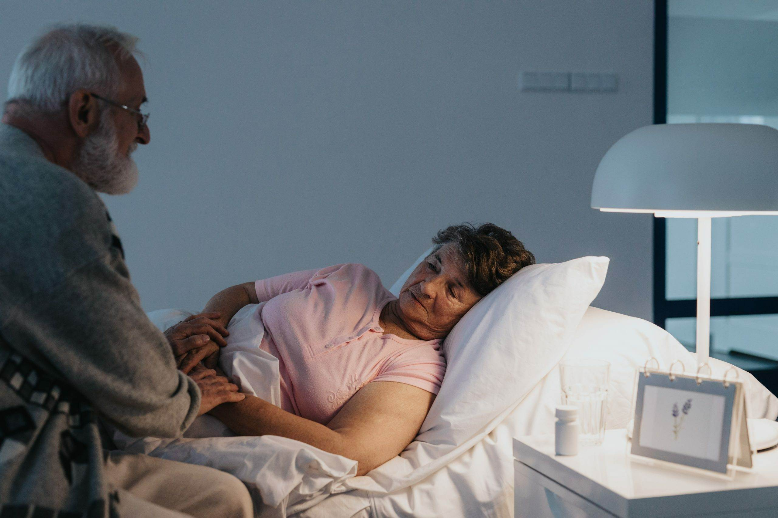 A dying woman is seen thinking about what to do after death with her partner